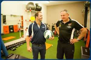 Brisbane Roar conditioning coach Ken Stead (right) showed the young players around the Ballymore facilities.